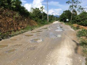 Motorbike in vietnam potholes